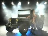 Army show: Bruna Ferraz anally presents jeep