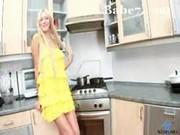 Miss masturbates in the kitchen
