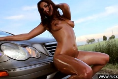 Alluring girl sucks shifter of luxury car