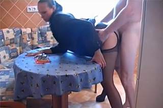 Amateur couple banging on the table instead of eating dinner
