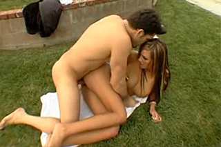 Amy Reid fucking her lover in a huge garden in front of the house