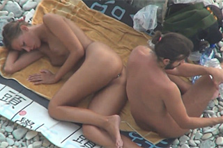 Anal shooting on a nude beach!