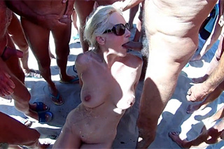 Blowbang with a mature woman on a French nude beach!