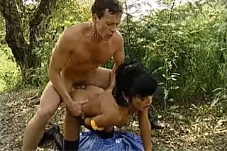 Black haired milf gets her asshole stretched in the forest
