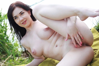 Czech kitten Daphne Angel performs shaved pussy by a water