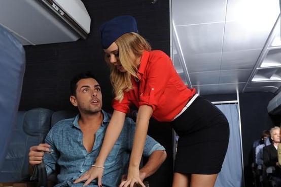 Stewardess Alexis Adams friendly to apassenger on the flight