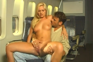 Stewardess Bobbi Eden is fucking with a passenger