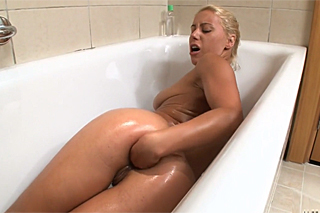 Luxury blonde performs anal fisting in the bathtub!