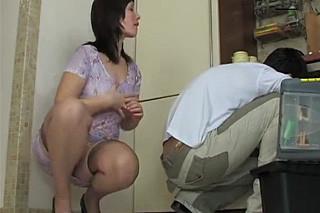 Young Russian housewife fucked by a repairman in the kitchen