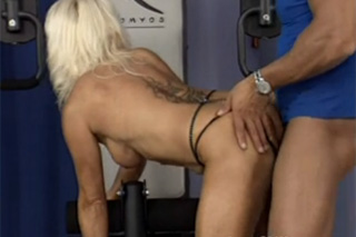Horny granny fucking in the gym with fitness coach