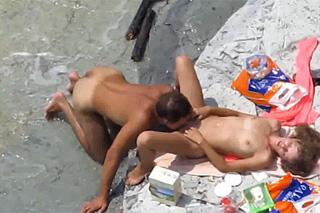 Horny amateurs are sexing on a stone beach - Hidden camera