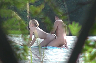 Naturist couple having sex outdoor in front of a hidden camera