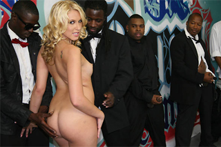 Blonde Katie Summers and a group of black stallions - gang bang porn