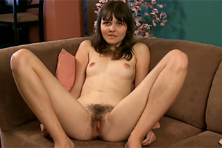 Inexperienced lolita shows her hairy pussy on camera