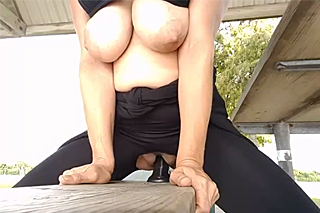 Courageous busty wife is masturbating in a park!