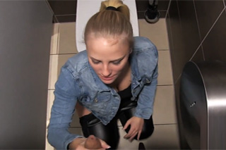 Busty blonde fucks with boyfriend in a restaurant's toilet