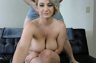 Busty blonde with bearded partner on webcam
