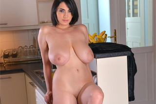 Busty lady Luna Amor is gently teasing her hole in the kitchen