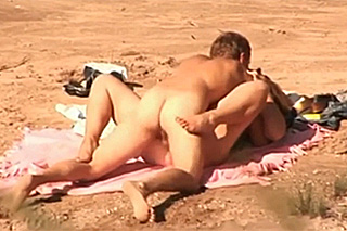 Passionate fucking on a beach