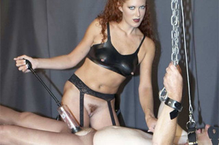 Ginger dominatrix Sabrina Fox playing with her slave's cock - BDSM porn